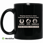 Staying Human Is More Important Than Living In Fear Hands Face Embrace Mug