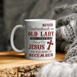 Never Underestimale An Old Lady Who Is Covered By The Blood Of Jesus And Was Born In December Mug