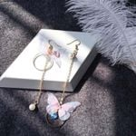 Retro asymmetrical exquisite butterfly imitation pearl Earrings