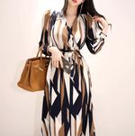 Sexy Striped Print V-neck Bow Bandage Vintage Office Dress