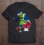 Tennessee Titans Grinch Sitting On Houston Texans Toilet And Step On Jacksonville Jaguars Helmet Football T Shirt