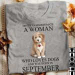 Never underestimate a woman who loves dogs and was born in september puppy dog t shirt hoodie sweater
