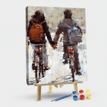 Back view of couple riding bicycle
