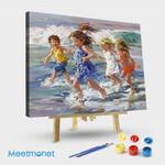 Children running by the sea