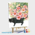 Black cat under daffodil