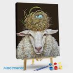 Sheep with a birdhouse