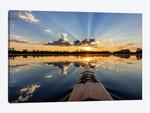 Kayaking into sunset rays on McWennger Slough, Kalispell, Montana, USA