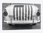 USA, Massachusetts, Essex. Antique cars, detail of 1950's-era Ford draped with US flag.