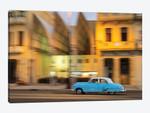 Cuba, Havana, classic car in motion at dusk on Malecon.