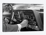 1960s Hand On Car Radio Dials And Steering Wheel