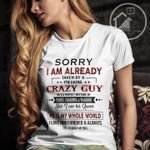 Sorry i am already taken by a freaking crazy guy he is my whole world husband boyfriend shirt