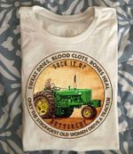 Sweat dries blood clots bones heal only the strongest old women drive a tractor farm t-shirt