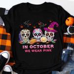 in october we wear pink three skulls decorated in festive season Halloween t shirt best gift for halloween lovers Tshirt