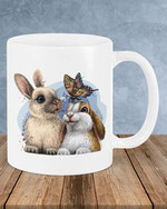Two lovely bunnies playing with a flying butterfly mug bets gift for rabbit lovers Ceramic Mug