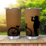 Silhouette Woman Sit Near Bicycle On Shining Tumbler