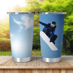 Snowboarder Jumping Against Blue Sky Shining Tumbler