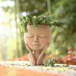 Estatua artística creativa en forma de florero
